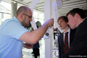 Students from St. Columba's College chatting to CRANN researcher Amir Sajad Esmaeily at the 'Invincible & Invisible' stand. Magical Materials consists of a number of interactive stands. The materials are often very small and look quite ordinary to the naked eye. A quick demonstration reveals the extraordinary properties that lie within.