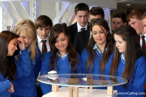 Magnetic levitation being demonstrated to students from St. Columba's College and Eureka Secondary School. The material is cooled using liquid nitrogen to around -200 degrees Celsius which enables it to become a superconductor (a metal that will conduct electricity without any resistance).